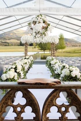 Outdoor tent wedding Aspen Colorado ranch with wood slab on church table for guest book display
