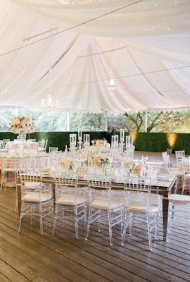 calamigos ranch tented wedding reception, draped fabric with twinkle lights, boxwood hedges