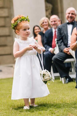 White flower girl dress, pomander ball, green leaf flower crown, rosette details on skirt