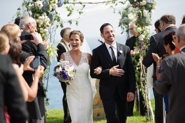 Melissa Claire Egan and groom walk up aisle as husband and wife