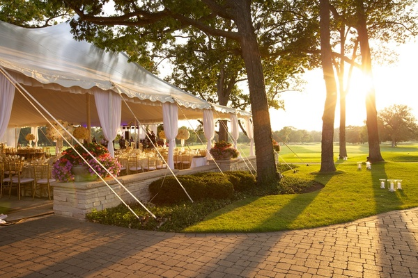 Tented wedding on golf course of country club in Illinois