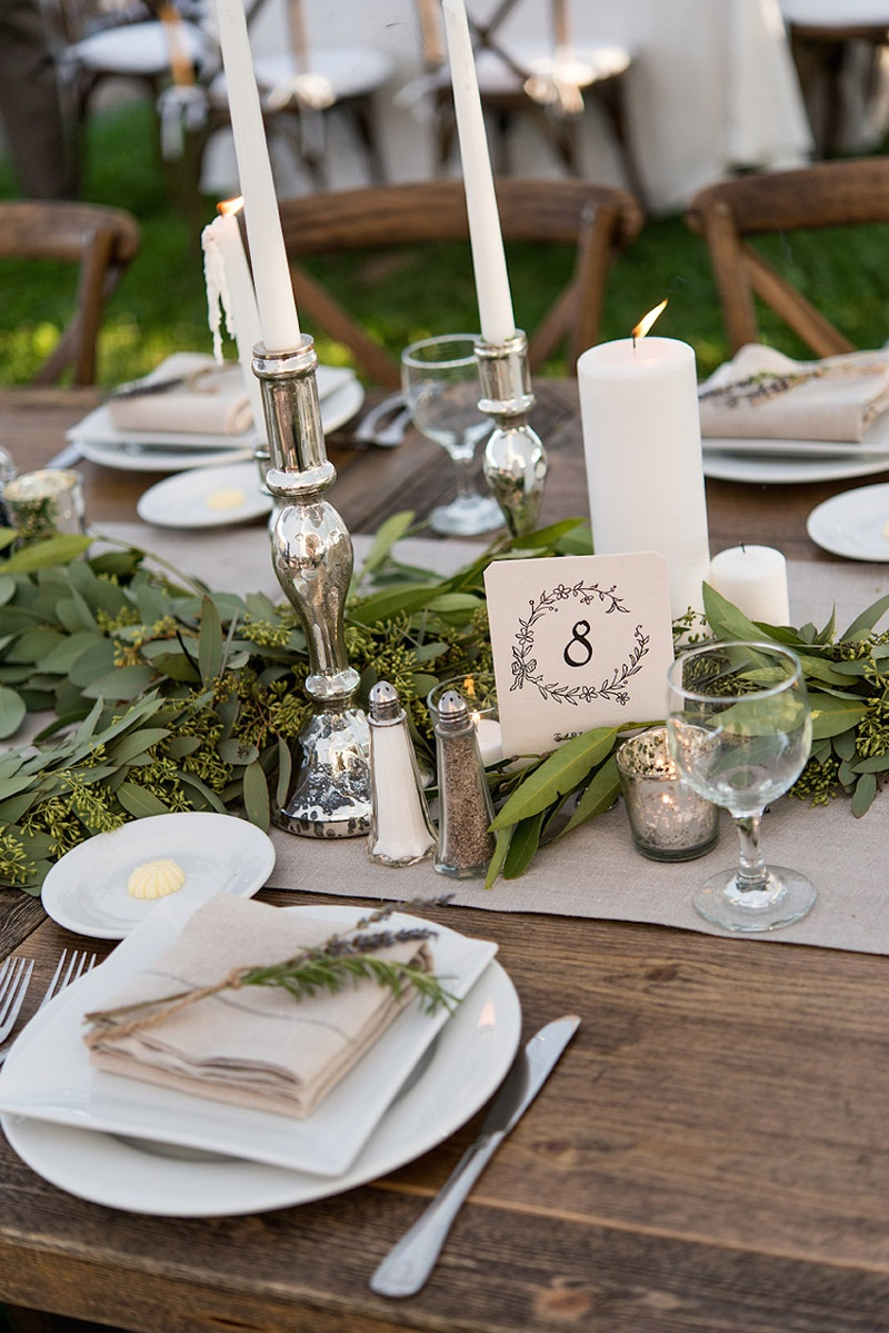 Rustic Wedding Reception Wood Table With Number In Drawn Wreath Design Silver Candlesticks