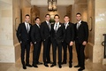 Groom with groomsmen in tuxedos and dress shoes