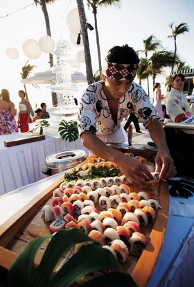 chef preparing wooden boat filled with sushi