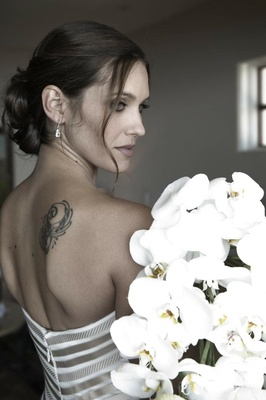 Bride in a strapless Vera Wang gown with gathered loose curls