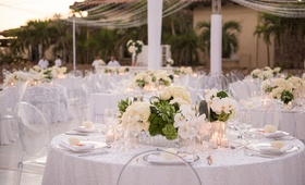 mirrored boxes, cream roses, moss, white orchids