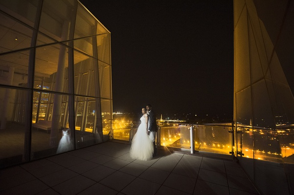 bride and groom on rooftop deck at night in chicago
