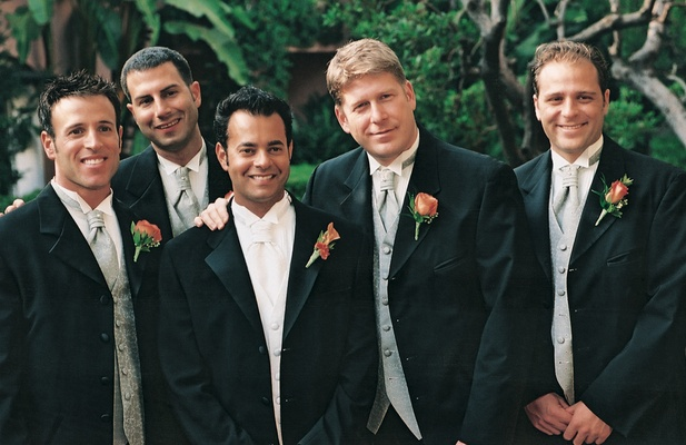 groom and groomsmen wearing blue ties and vests