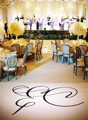 Black calligraphy monogram on white wedding carpet