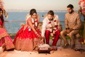 bride in lehnga and groom in sherwani mandap indian wedding traditions pacific ocean view