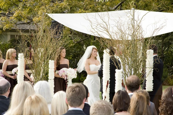 Bride and bridesmaids at alfresco wedding ceremony