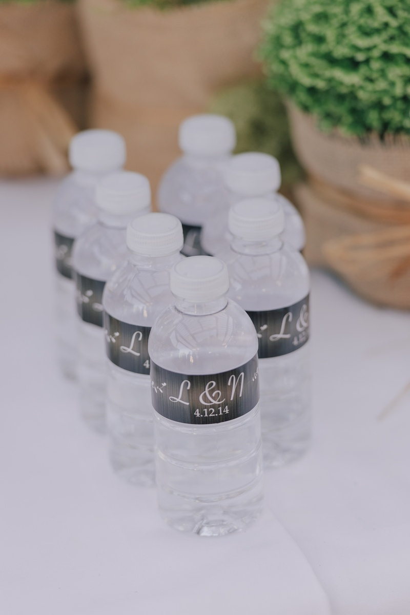 Small water bottle with personalized wedding label