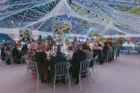 wedding guests at clear tent reception twinkle lights matthew lawrence cheryl burke reception