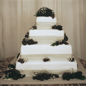 Bride's cake with fresh grapes and ivory ribbon