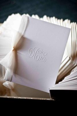 Wedding monogram emboss on white stationery with bow