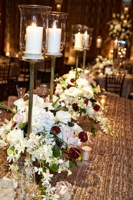 small floral arrangements with white blush and wine colored flowers with tall candles