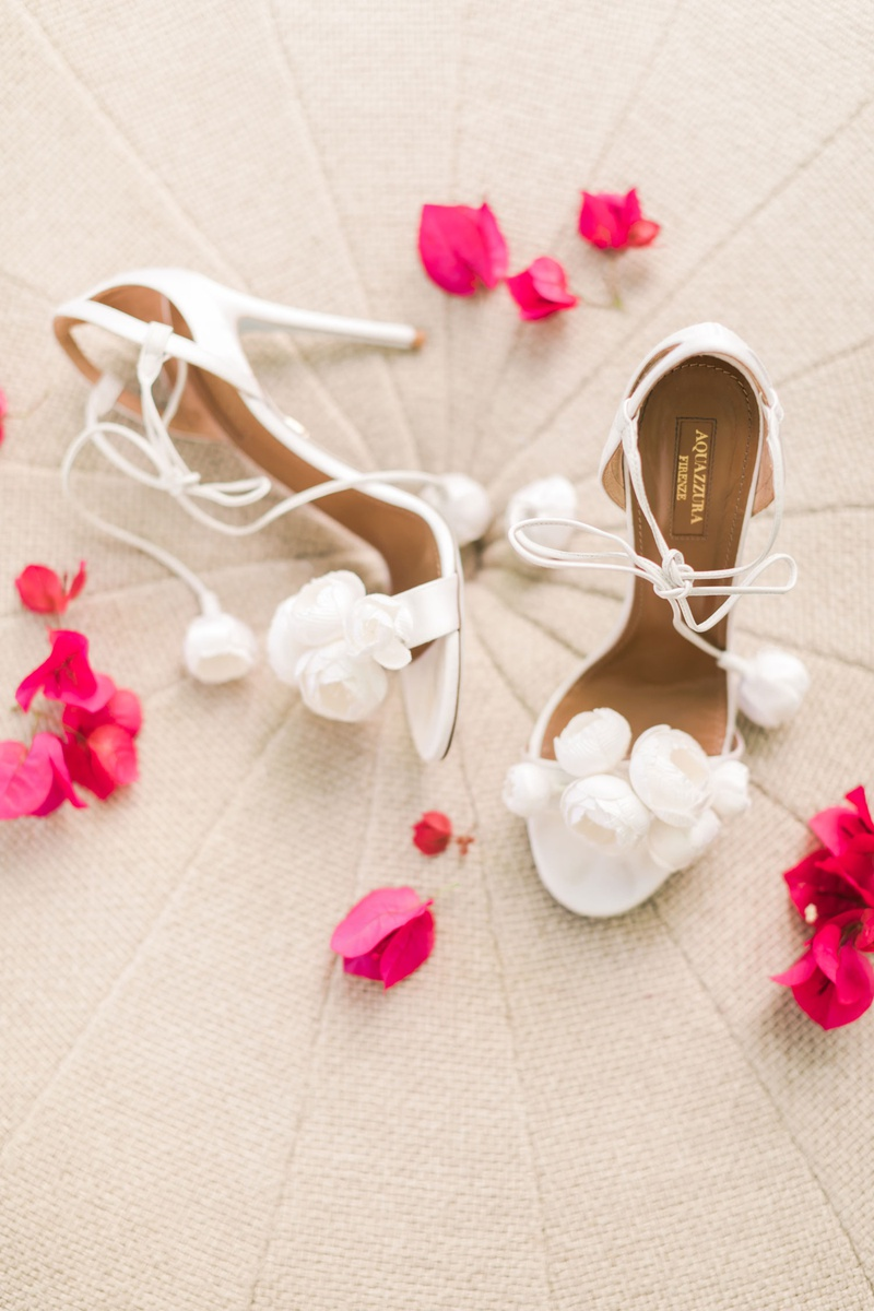 white aquazzura strappy white heels with pom poms flowers on toe and straps