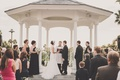 Bride and groom married beneath oceanfront rotunda