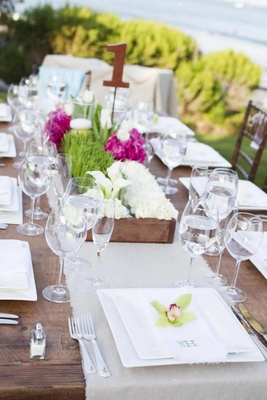 Wood table and linen runner with garden boxes
