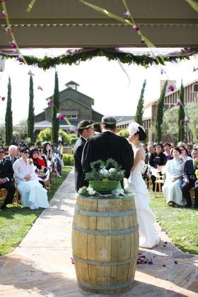 Bride and groom in front of vineyard wedding altar