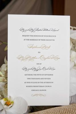 White wedding invitation with black script and gold script sophisticated classic invite