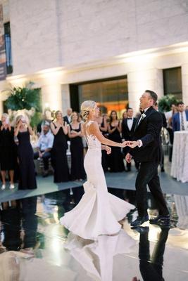 wedding reception first dance mirror dance floor bride in pronovias gown bustle for dancing updo