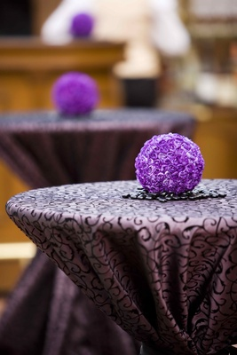 Two-toned purple linens and carnation pomander ball