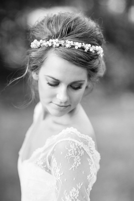 Black and white photo of young bride with headband