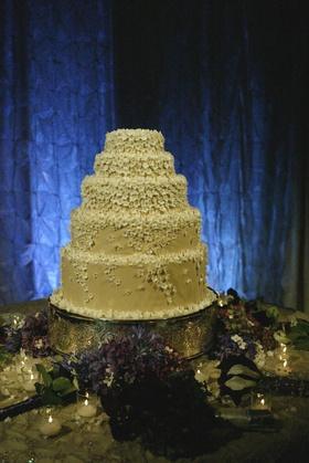 Five layer buttercream cake with stephanotis