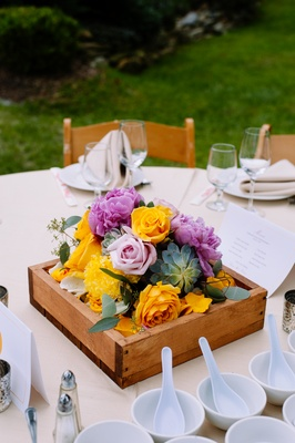Wood box centerpiece with succulents and roses