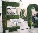 Towering initials made from manicured hedges