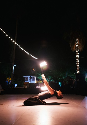 Destination wedding ideas fire dancer mexico wedding on dance floor fire baton twirling