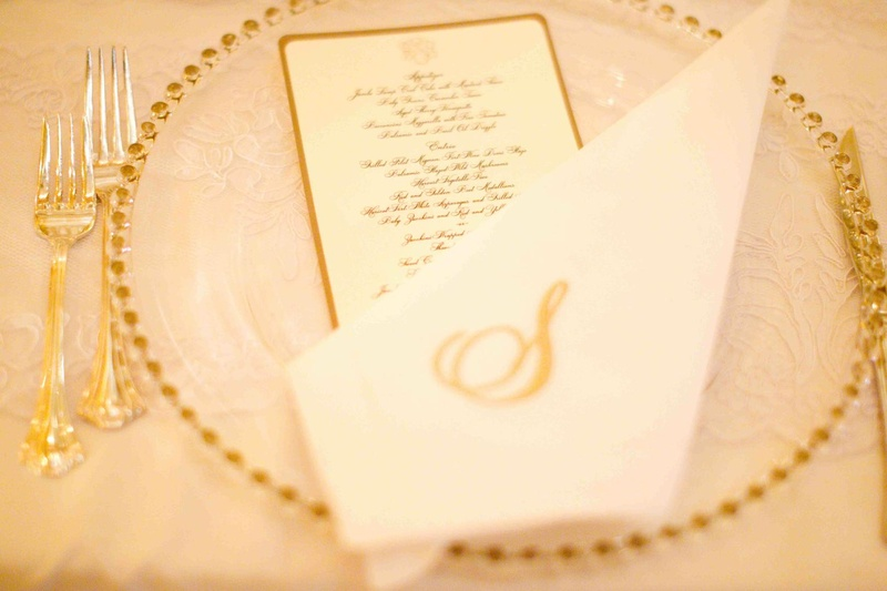 Gold bead charger plate with gold menu and monogram napkin