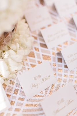 Wedding reception cocktail hour escort card gold calligraphy gold silver linens