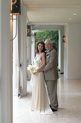 Off-white wedding dress and groom in dark khaki