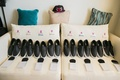 the black and white dress shoes laid out for the groomsmen Vans leather look