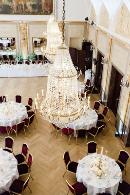 wedding reception in germany hotel grand chandelier crystal gold details aerial view of reception