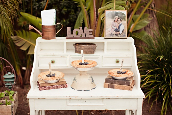 Vintage white desk with blueberry pies