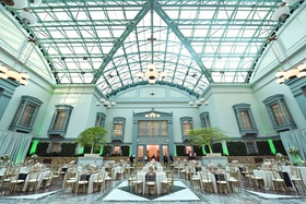 Harold Washington Library wedding reception skylight neutral decor blue runner gold details gay lgbt