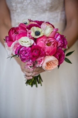 Bridal wedding bouquet with pink peony, white anemone, pink and peach garden roses