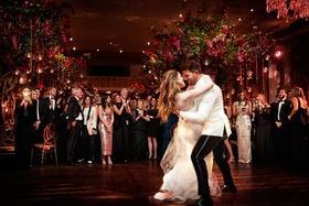 bride in vera wang wedding dress groom in white jacket first dance beautiful photo dip guests watch