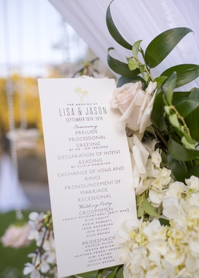 wedding ceremony program with order of events and list of wedding party