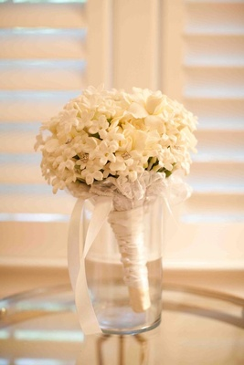 Gardenia, stephanotis, and lily of the valley bridal bouquet