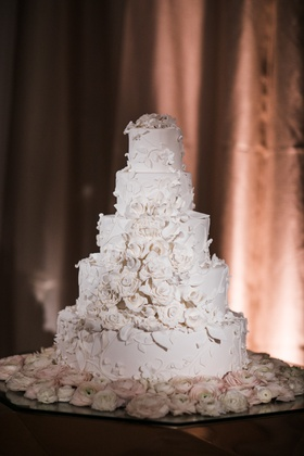 Wedding cake five layer white cake with flower appliques sugar flowers like bridal gown wedding dres