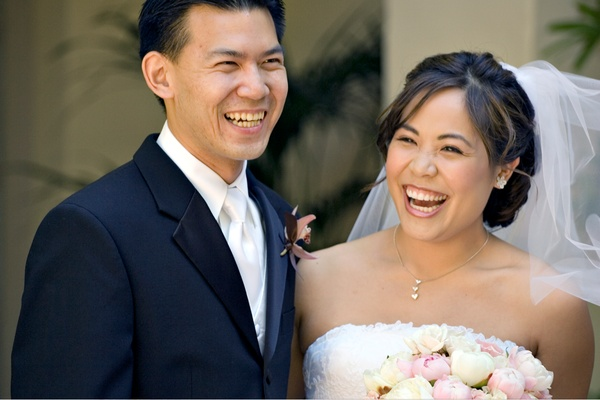 Man in tuxedo and woman in Vera Wang gown
