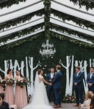 wedding ceremony decor clear top tent greenery chandelier hedge wall birch tree design bridesmaids