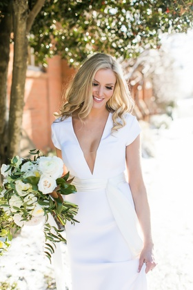 blonde bride with soft curls, v-neck short sleeve gown by gregory ellenberg