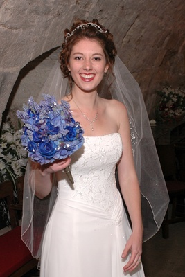 Bride in Scottish castle in strapless white wedding dress and blue bouquet