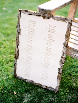 Outdoor wedding reception with a seating chart