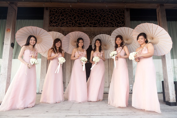 Bridesmaids in pink dresses with parasols